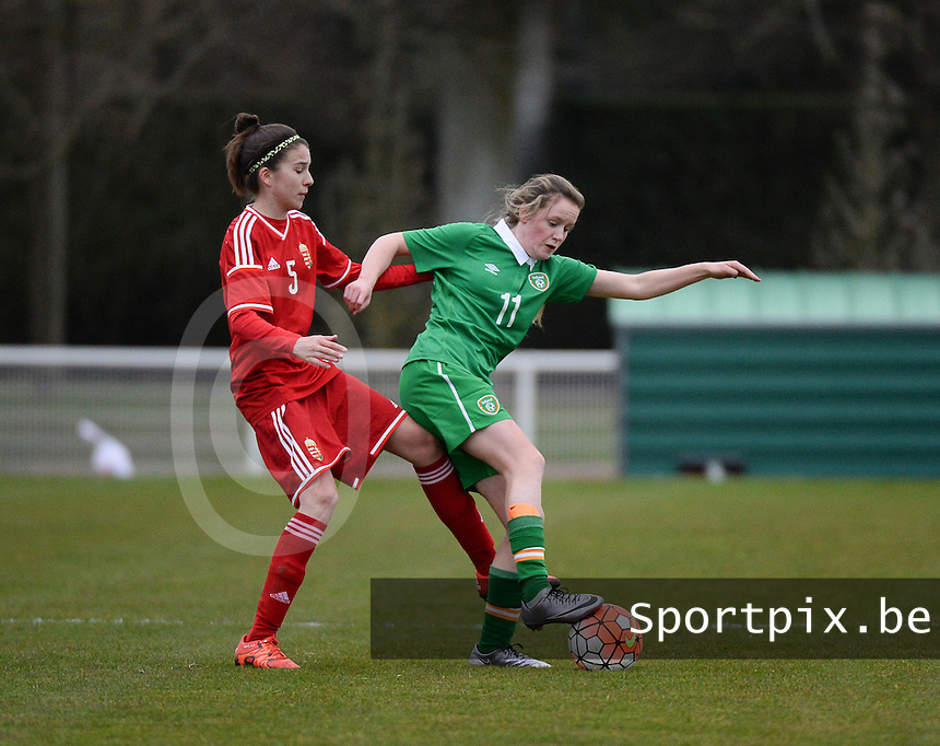 20160319 - BAYEUX , FRANCE : Irish Heather Payne (R) and Hungarian Anna Julia Csiki (L) pictured during the soccer match between the women under 17 teams of The Republic of Ireland and Hungary , on the first matchday in group 3 of the UEFA Women Under17 Elite rounds at Stade Henry Jeanne in Bayeux , France . Saturday 19th March 2016 . PHOTO DIRK VUYLSTEKE