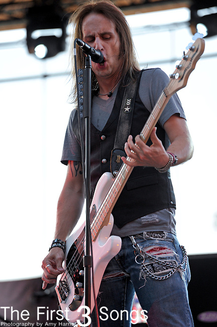 Jon Lawhon of Black Stone Cherry performs during the Carnival of Madness tour at the Kentucky State Fair's Cardinal Stadium on Friday, August 26, 2011.