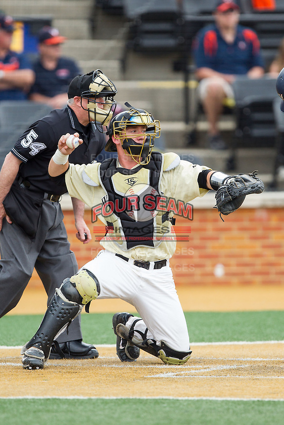 Wake Forest Demon Deacons catcher Ben Breazeale (9) throws the ball back to his pitcher during the game against the Virginia Cavaliers at Wake Forest Baseball Park on May 17, 2014 in Winston-Salem, North Carolina.  The Demon Deacons defeated the Cavaliers 4-3.  (Brian Westerholt/Four Seam Images)