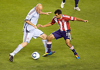 Colorado Rapids forward Conor Casey attempts to move past Chivas USA defender Jonathan Bornstein. The Colorado Rapids defeated the Chivas USA 1-0 at Home Depot Center stadium in Carson, California on Friday evening March 26, 2010.  .