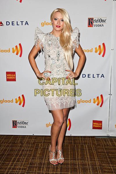 Kaya Jones.23rd Annual GLAAD Media Awards - Arrivals held at Westin Bonaventure Hotel, Los Angeles, California, USA..April 21st, 2012.full length white dress embellished jewel encrusted hands on hips.CAP/ADM/ES.©Emiley Schweich/AdMedia/Capital Pictures.