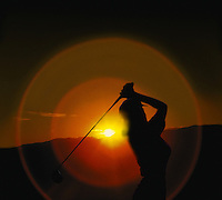 Woman Golfer teeing off Sunset silhouette, Golfing