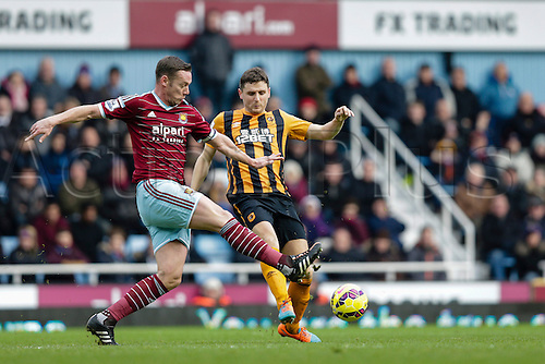 18.01.2015.  London, England. Barclays Premier League. West Ham versus Hull City.  West Ham United's Kevin Nolan with a challenge on Hull City's Alex Bruce