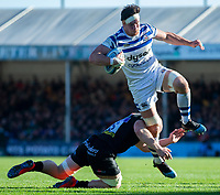 Bath Rugby's Francois Louw is tackled by Exeter Chiefs' Matt Kvesic<br /> <br /> Photographer Bob Bradford/CameraSport<br /> <br /> Premiership Rugby Cup - Exeter Chiefs v Bath Rugby - Sunday 24th March 2019 - Sandy Park - Exeter<br /> <br /> World Copyright © 2018 CameraSport. All rights reserved. 43 Linden Ave. Countesthorpe. Leicester. England. LE8 5PG - Tel: +44 (0) 116 277 4147 - admin@camerasport.com - www.camerasport.com