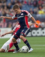 New England Revolution midfielder Kelyn Rowe (11) drives for the net as Portland Timbers defender Eric Brunner (5) defends. In a Major League Soccer (MLS) match, the New England Revolution defeated Portland Timbers, 1-0, at Gillette Stadium on March 24, 2012