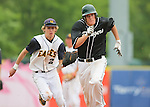 Forest Hills Central center fielder Mick Van Vossen is chased down by Hudsonville's second baseman during a game at Fifth Third Ballpark in Comstock Park, Michigan on May 28, 2011. (Photo by Bob Campbell)