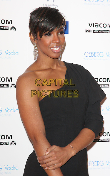 KELLY ROWLAND.MTV Staying Alive Foundation Dinner at the Westbury Hotel, Mayfair, London - .January 27th, 2011.half length black one shoulder sleeve long hand dangling silver earrings.CAP/ROS.©Steve Ross/Capital Pictures