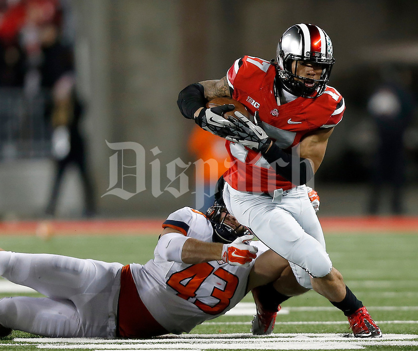 Ohio State Buckeyes running back Jalin Marshall (17) tries to get away from Illinois Fighting Illini linebacker Mason Monheim (43) in the first quarter of the NCAA football game at Ohio Stadium on Saturday, November 1, 2014. (Columbus Dispatch photo by Jonathan Quilter)