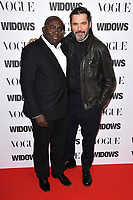 "Edward Enninful and Roland Mouret<br /> arriving for the ""Widows"" special screening in association with Vogue at the Tate Modern, London<br /> <br /> ©Ash Knotek  D3457  31/10/2018"