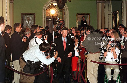 United States Representative James E. Rogan (Republican of California), in red tie, is surrounded by reporters and photographers outside the U.S. Senate Chamber in the U.S. Capitol in Washington, D.C. on January 14, 1999.  Rogan made his presentation prior to meeting the press..Credit: Ron Sachs / CNP