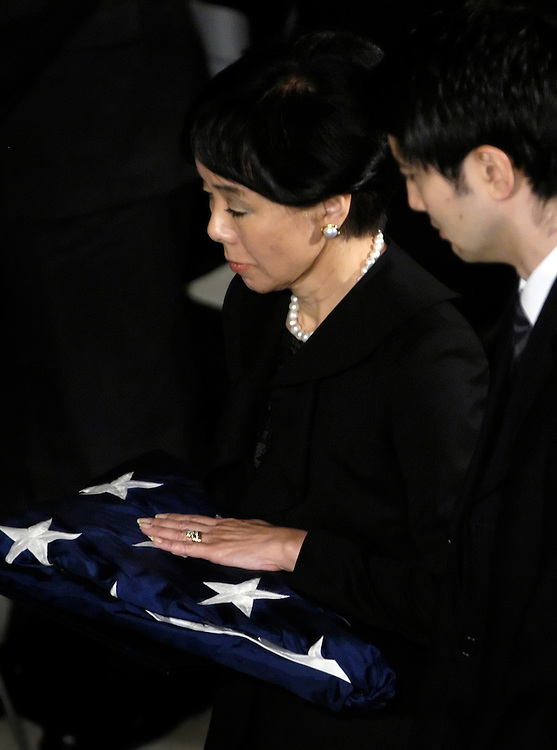 Rep. Matsui's wife, Doris, and son, Brian, receive a flag at Rep. Robert Matsui's memorial service in Statuary Hall in the Capitol. Matsui died on New's Day at age 63 of a rare blood disease.