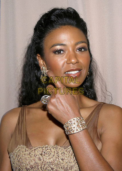 ANANDA LEWIS.Miramax, Coors Light, AMC & Glamour Magazine present the 2005 Golden Globes After Party held at the Beverly Hilton Hotel, Beverly Hills, California, USA,.16th January 2005  .portrait headshot touching earring jeweelery pointing out.Ref: ADM.www.capitalpictures.com.sales@capitalpictures.com.©Jacqui Wong/AdMedia/Capital Pictures .