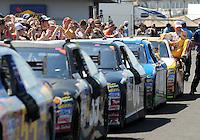 Apr 25, 2009; Talladega, AL, USA; NASCAR Sprint Cup Series driver Jeff Gordon climbs from his car during qualifying for the Aarons 499 at Talladega Superspeedway. Mandatory Credit: Mark J. Rebilas-