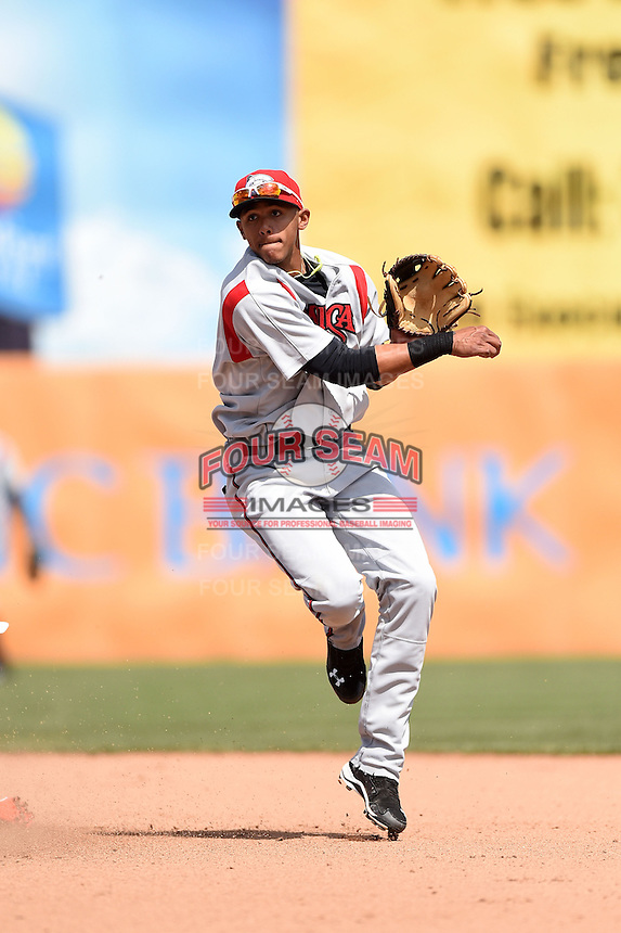 Carolina Mudcats shortstop Erik Gonzalez (10) attempts to turn a double play during a game against the Frederick Keys on April 26, 2014 at Harry Grove Stadium in Frederick, Maryland.  Carolina defeated Frederick 4-2.  (Mike Janes/Four Seam Images)