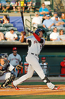 Hickory Crawdads first baseman Ronald Guzman (20) at bat during a game against the Charleston RiverDogs at Joseph P. Riley Jr. Ballpark on May 2, 2015 in Charleston, South Carolina. Hickory defeated Charleston 4-1. (Robert Gurganus/Four Seam Images)