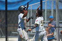 GCL Pirates right fielder Jeremias Portorreal (16) is congratulated by Francisco Mepris (56) after hitting a grand slam home run in the top of the eleventh inning during a game against the GCL Blue Jays on July 20, 2017 at Bobby Mattick Training Center at Englebert Complex in Dunedin, Florida.  GCL Pirates defeated the GCL Blue Jays 11-6 in eleven innings.  (Mike Janes/Four Seam Images)