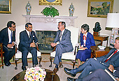 United States President George H.W. Bush, right, meets President Zine El Abidine Ben Ali of Tunisia in the Oval Office of the White House in Washington, D.C. on November 16, 1989.  Vice President Dan Quayle looks on from the far right..Credit: Ron Sachs / CNP
