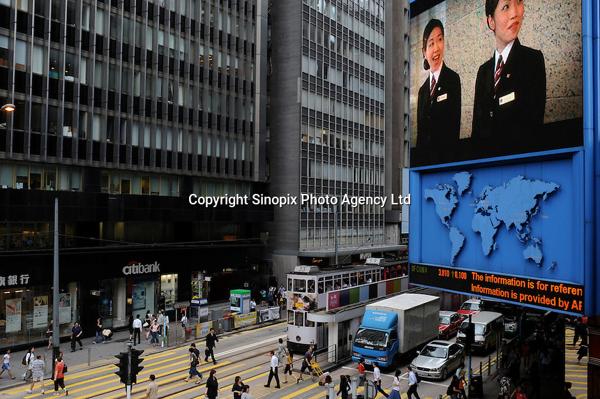 Big screens on Des Voeux Road in Central business district, Hong Kong..