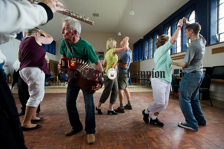 """Dance teacher Timmy, """"The Brit"""" Mc Carthy plays for his pupils during the Willie Clancy Week at Miltown Malbay. Photograph by John Kelly."""