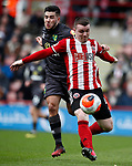 John Fleck of Sheffield Utd goes past Emi Buendia of Norwich City  during the Premier League match at Bramall Lane, Sheffield. Picture date: 7th March 2020. Picture credit should read: Simon Bellis/Sportimage