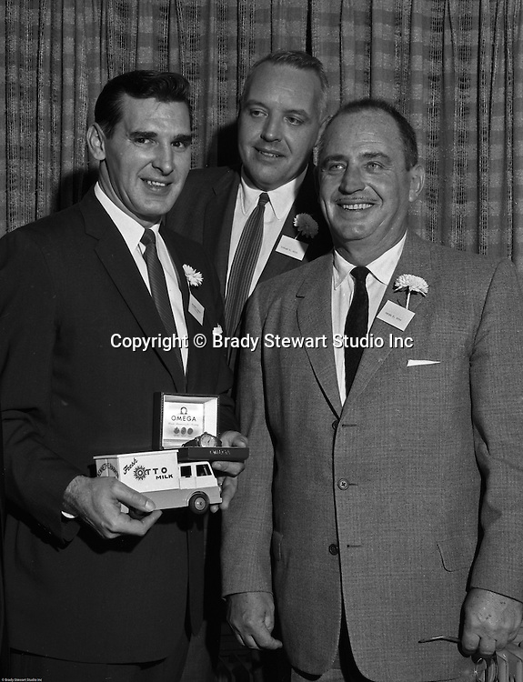 Pittsburgh PA:  View of Oscar and Thomas Otto presenting an award to a salesman during a company meeting - 1961.  PR assignment for Ketchum McLeod and Grove Advertising