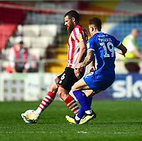 Lincoln City's Michael Bostwick clears under pressure from Tranmere Rovers' Kieron Morris<br /> <br /> Photographer Andrew Vaughan/CameraSport<br /> <br /> The EFL Sky Bet League Two - Lincoln City v Tranmere Rovers - Monday 22nd April 2019 - Sincil Bank - Lincoln<br /> <br /> World Copyright © 2019 CameraSport. All rights reserved. 43 Linden Ave. Countesthorpe. Leicester. England. LE8 5PG - Tel: +44 (0) 116 277 4147 - admin@camerasport.com - www.camerasport.com