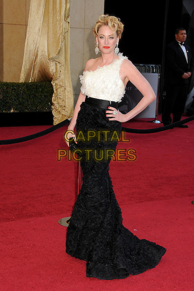 VIRGINIA MADSEN .At the 83rd Annual Academy Awards - Arrivals held at the Kodak Theatre,  Hollywood, California, USA, 27th February 2011..oscars full length black white dress one shoulder skirt top feathers clutch bag hand on hip.CAP/ADM/BP.©Byron Purvis/AdMedia/Capital Pictures.
