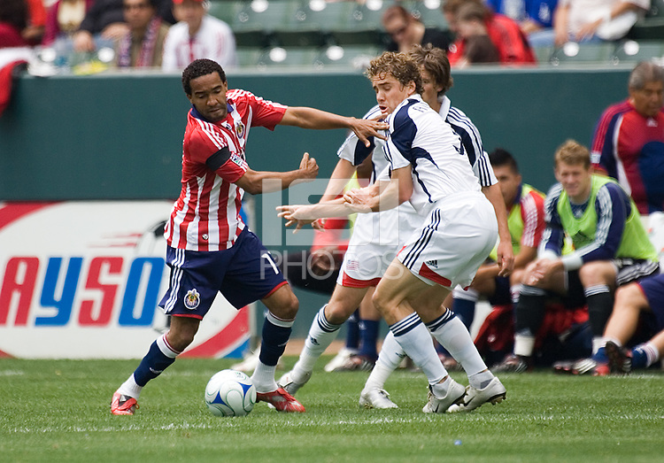 ChivasUSA forward Maykel Galindo (11) pushes off on New England Revolution defender Chris Albright (3) during a MLS game. The New England Revolution defeated the Chivas USA 2-1 at Home Depot Center Stadium, in Carson, Calif., on Sunday, May 11, 2008.