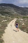 Mountain path in carboniferous limestone landscape, near Benimaurell, Vall de Laguar, Marina Alta, Alicante province, Spain