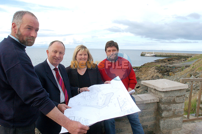 Minister Dermot Ahern looks at the plans for the new Port Oriel development after announcing an adtional 1.5 Million Euro in Funding pictured with Oliver Kirwan, Jackiwe McConville and Barry Faulkner..Photo AFP/NEWSFILE/FRAN CAFFREY..(Photo credit should read FRAN CAFFREY/NEWSFILE/AFP)...This Picture has been sent you under the condtions enclosed by:.Newsfile Ltd..the Studio,.Millmount Abbey,.Drogheda,.Co Meath..Ireland..Tel: +353(0)41-9871240.Fax: +353(0)41-9871260.GSM: +353(0)86-2500958.email: pictures@newsfile.ie.www.newsfile.ie.FTP: 193.120.102.198..This picture is from Fran Caffrey@newsfile.ie
