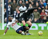 26th December 2019; Tottenham Hotspur Stadium, London, England; English Premier League Football, Tottenham Hotspur versus Brighton and Hove Albion; Aaron Connolly of Brighton & Hove Albion is tackled by Serge Aurier of Tottenham Hotspur - Strictly Editorial Use Only. No use with unauthorized audio, video, data, fixture lists, club/league logos or 'live' services. Online in-match use limited to 120 images, no video emulation. No use in betting, games or single club/league/player publications