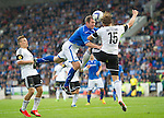 St Johnstone v Rosenborg....25.07.13  Europa League Qualifier<br /> Frazer Wright goes head to head with Alexander Soderlund<br /> Picture by Graeme Hart.<br /> Copyright Perthshire Picture Agency<br /> Tel: 01738 623350  Mobile: 07990 594431