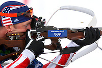 USA's Jeremy Teela of Anchorage, Alaska fires his rifle while competing in the men's 12.5 k pursuit biathlon at the XXI Olympic Winter Games Tuesday, February, 16, 2010 at Whistler Olympic Park in Whistler, British Coulmbia.