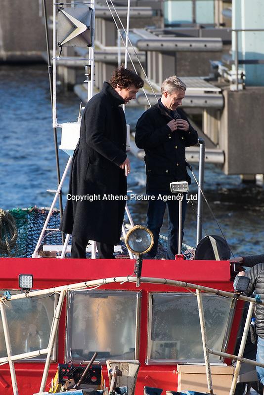 Benedict Cumberbatch and Martin Freeman seen filming scenes on a fishing boat of hit BBC series Sherlock in Cardiff, Wales, UK