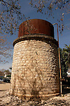 "Israel, Jezreel Valley. The abandoned Afula station of the old ""Valley Train"", the water tower"