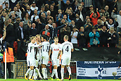 13th September 2017, Wembley Stadium, London, England; Champions League Group stage, Tottenham Hotspur versus Borussia Dortmund; Harry Kane of Tottenham Hotspur celebrates with team mates after scoring making it 3-1