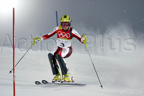 22 February 2006: Austrian skier Nicole Hosp (AUT) skiing the 2nd run of the Women's Slalom at Sestriere in the 2006 Turin Winter Olympics. Hosp finished in 2nd place Photo: Neil Tingle/actionplus....olympics 060222 torino happy woman female snow