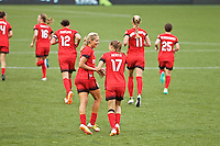 Portland, OR - Saturday, May 21, 2016: Portland Thorns FC midfielder Allie Long (10) and midfielder Tobin Heath (17) celebrate. The Portland Thorns FC defeated the Washington Spirit 4-1 during a regular season National Women's Soccer League (NWSL) match at Providence Park.