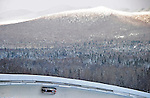 18 December 2010: Bree Schaaf slides through turn 14 with Whiteface Mountain in the background, finishing in 5th place for the USA at the Viessmann FIBT World Cup Bobsled Championships on Mount Van Hoevenberg in Lake Placid, New York, USA. Mandatory Credit: Ed Wolfstein Photo