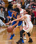 WINSTED,  CT-021919JS07-  Gilbert's Angelina Delacruz (11) tries to keep control of the ball while being defended by Northwestern's Francesca DeSanti  (2) and Skylar Dimartino (11) during their Berkshire League semi-final game Tuesday at Northwestern Regional High School in Winsted. <br /> Jim Shannon Republican American