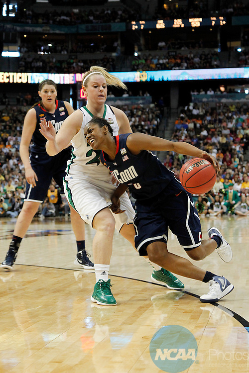 01 APRIL 2012:  Tiffany Hayes (3) of the University of Connecticut drives past Brittany Mallory (22) of the University of Notre Dame during the final seconds of regulation at the Division I Women's Final Four Semifinals at the Pepsi Center in Denver, CO.  Notre Dame defeated UCONN 83-75 to advance to the national championship game.  Jamie Schwaberow/NCAA Photos