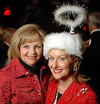 Kim Padgett and Carol Sawyer at the Carmen and David Bridges Joyful Toyful Fiesta 19th Annual Holiday Toy Drive Party at Gigi's Asian Bistro & Dumpling Bar in the Galleria Tuesday Dec. 01,2009. (Dave Rossman/For the Chronicle)