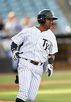 Tampa Yankees third baseman Jose Rosario (12) runs to first during a game against the Dunedin Blue Jays on June 28, 2014 at George M. Steinbrenner Field in Tampa, Florida.  Tampa defeated Dunedin 5-2.  (Mike Janes/Four Seam Images)