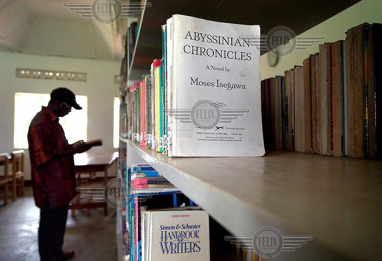 Moses Isegawa, a Ugandan writer whose books have been published around the world, visiting the library at the Catholic seminary in the village of Nyenga, where he studied when he was young. He is most famous for his novel 'Abyssinian Chronicles'.