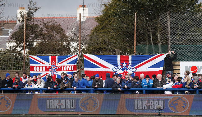 Rangers fans put up their flags at Links Park
