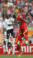 U.S. midfielder (17) DaMarcus Beasley goes up for a header against Ghana midfielder (8) Michael Essien. Ghana defeated the USA 2-1 in their FIFA World Cup Group E match at Franken-Stadion, Nuremberg, Germany, June 22, 2006. Ghana advances to round of 16 and the USA is out of the tournament.