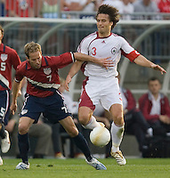 Eddie Lewis of the US holds back Vitalijs Astafjevs of Latvia at Rentschler Field, East Hartford, CT, May 28, 2006. The USA won 1-0.