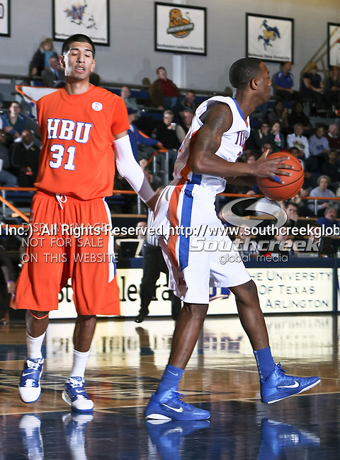 Texas-Arlington Mavericks guard/forward LaMarcus Reed III (31) gets a rebound from Houston Baptist Huskies forward Andrew Gonzalez (31) in the game between the UTA Mavericks and the Houston Baptist Huskies held at the University of Texas in Arlington's Texas Hall in Arlington, Texas. UTA defeats Houston Baptist 72 to 57