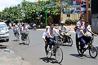 Schoolchildren cycling in Vung Tau, Vietnam