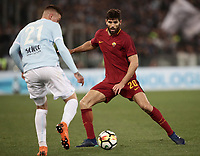 Calcio, Serie A: S.S. Lazio - A.S. Roma, stadio Olimpico, Roma, 15 aprile 2018. <br /> Roma's Federico Fazio(r) in action with Lazio's Sergej Milinkovic (l) during the Italian Serie A football match between S.S. Lazio and A.S. Roma at Rome's Olympic stadium, Rome on April 15, 2018.<br /> UPDATE IMAGES PRESS/Isabella Bonotto